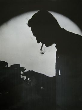 JRC with cigarette at typewriter-thumb-275x366