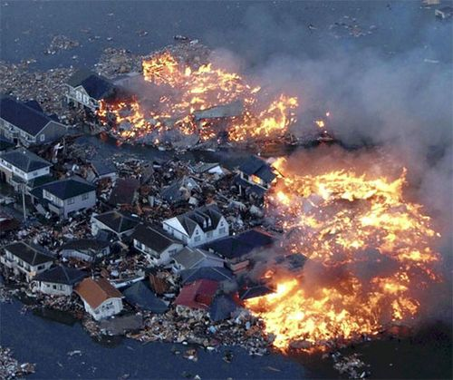 Houses-burn-in-Natori-City-after-8.9-earthquake-and-tsunami-slams-Japan.-March-11-2011
