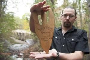 Chris holding jd foot wood