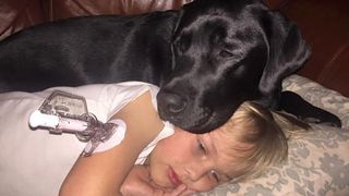 Boy-with-diabetes-and-service-dog-family-pic