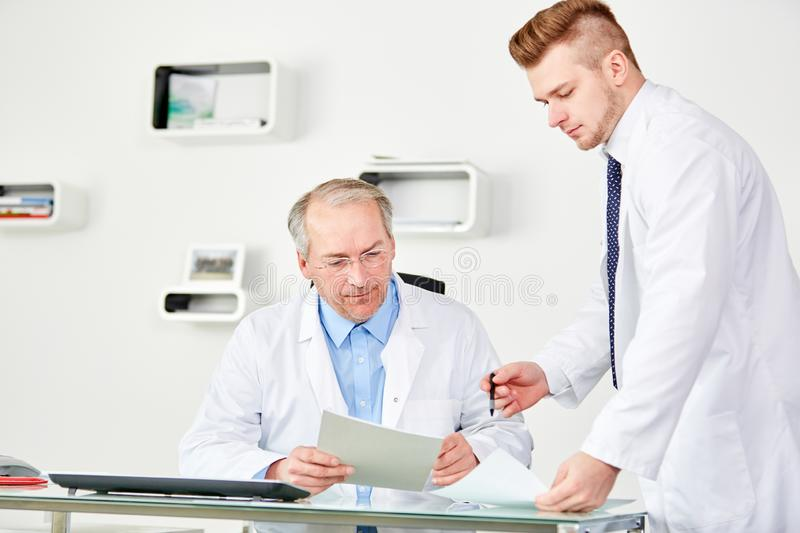 Senior-physician-assistant-clinic-office-132621900